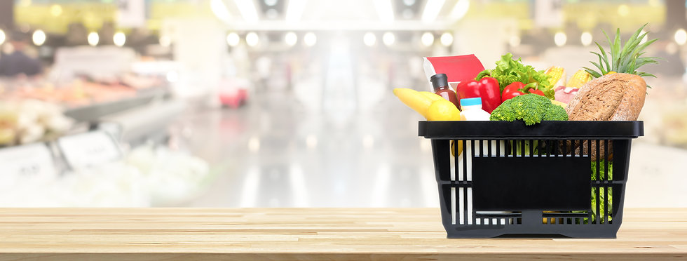 Food and groceries in shopping basket on