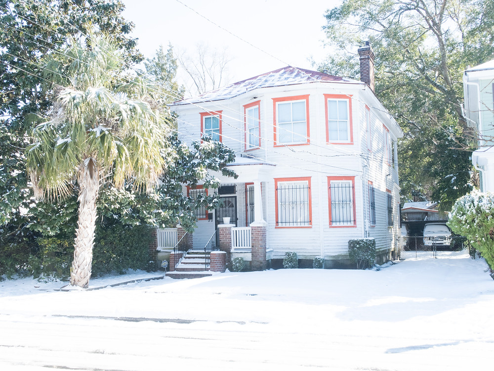 downtown charleston style home red trim in snow