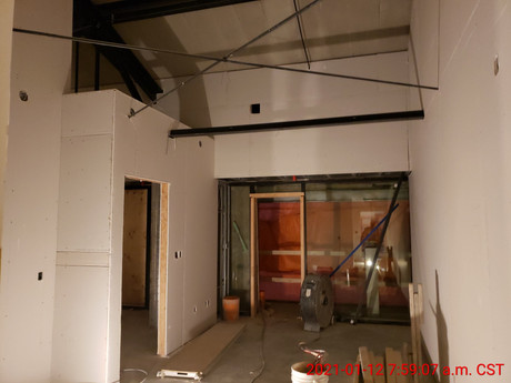 January 12, 2021  Drywall being installed in the living room and kitchen of suite 312.