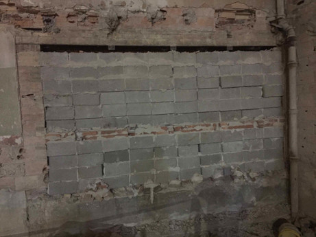"""November 21, 2019:   Inside view of south elevation. The existing block and brick infill which was installed during a previous renovation is visible. This area was """"hidden"""" behind the existing block wall, which ran from east to west between the first and second floor."""