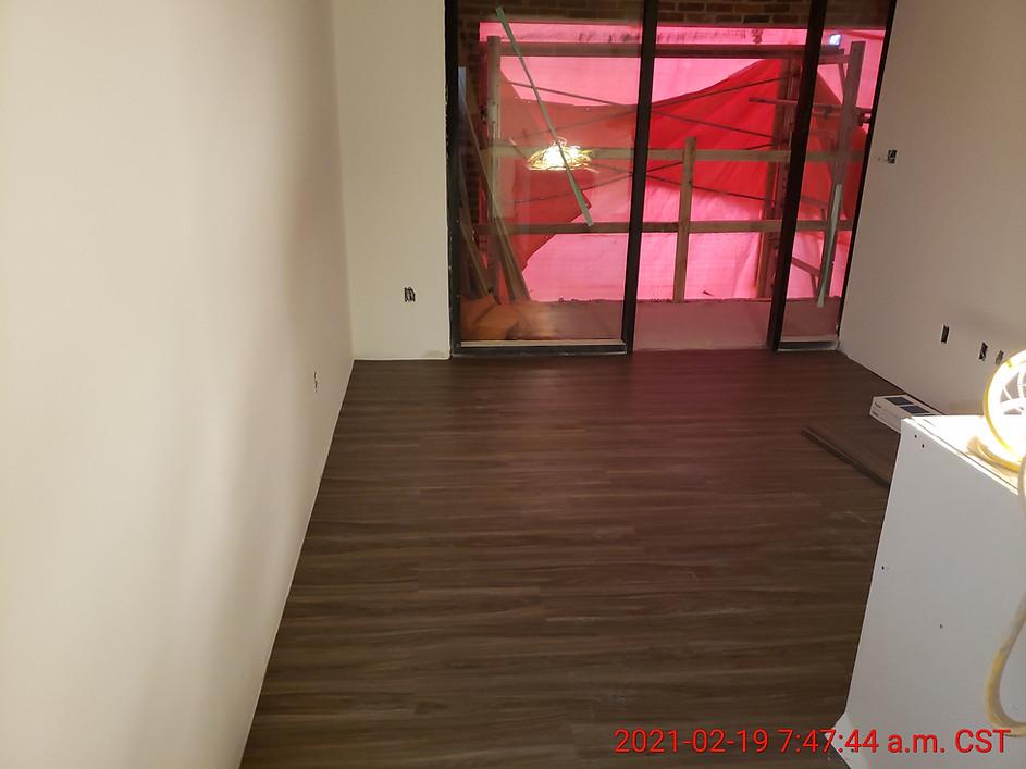 Suite 306 - living room flooring installation