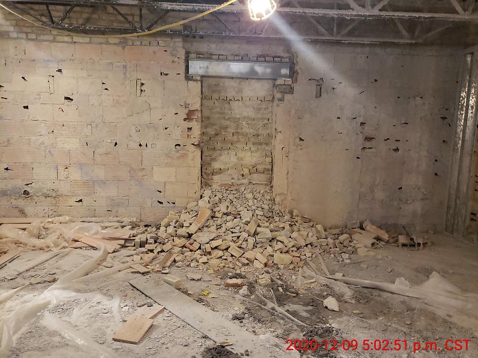 December 9, 2020  Starting to demolish brick wall for door 206C.