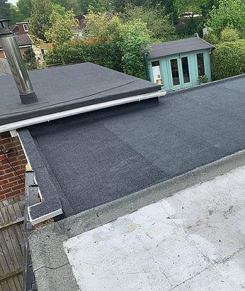 Flat roof installation sbs torch on felt