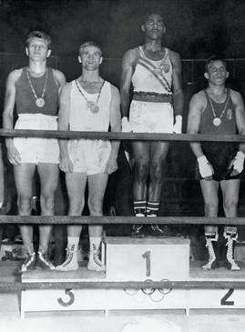 Pugilato, podio pesi medio massimi: 1° Cassius Clay;  2° Pietrzykowski ; 3° Madigan.