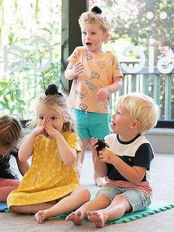 Children with spider puppets at a Little Bees Music Class