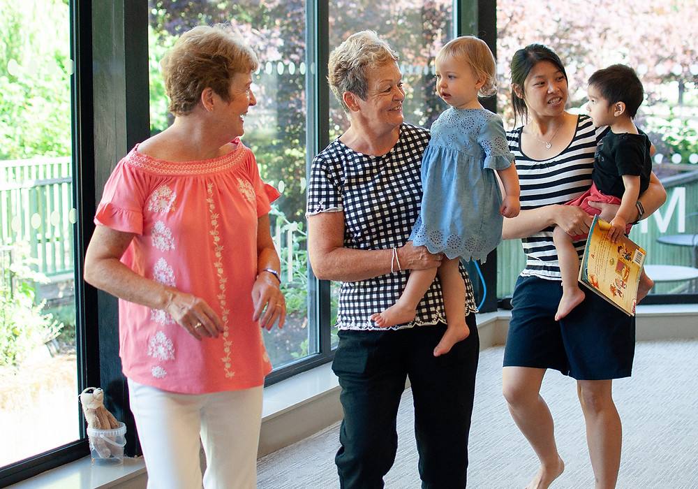 Grandparents and parents dancing with children in Little Bees class