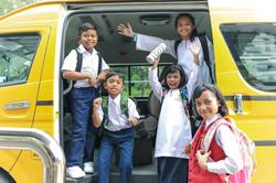 School Children getting on bus in Thaila