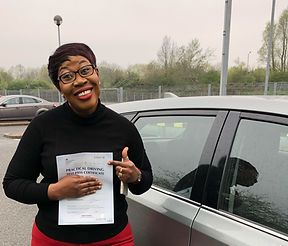 Happy learner driving holding pass certi