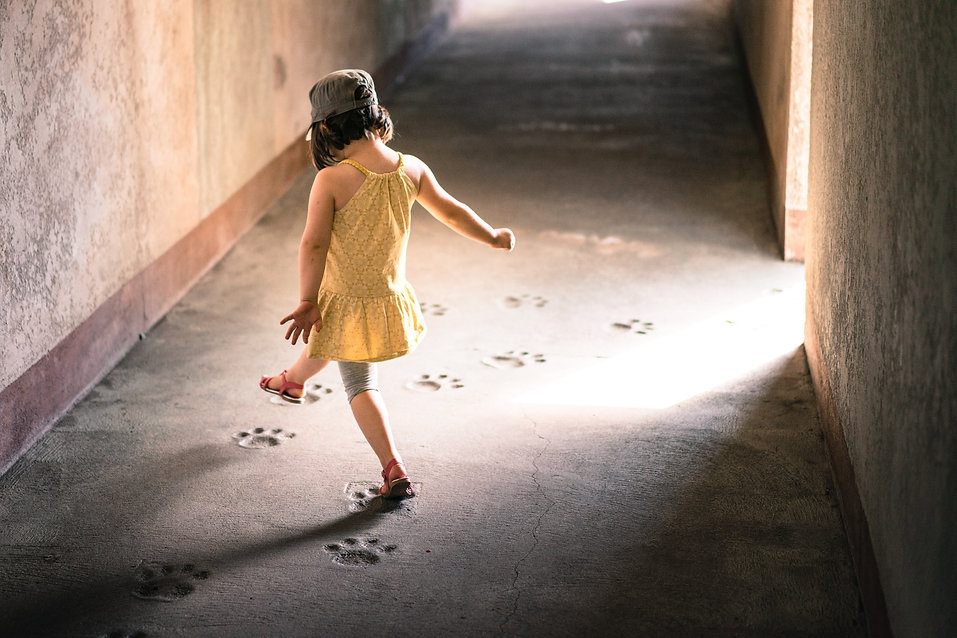 Child stepping in footprints