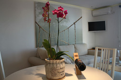 Orchid and wine on the table