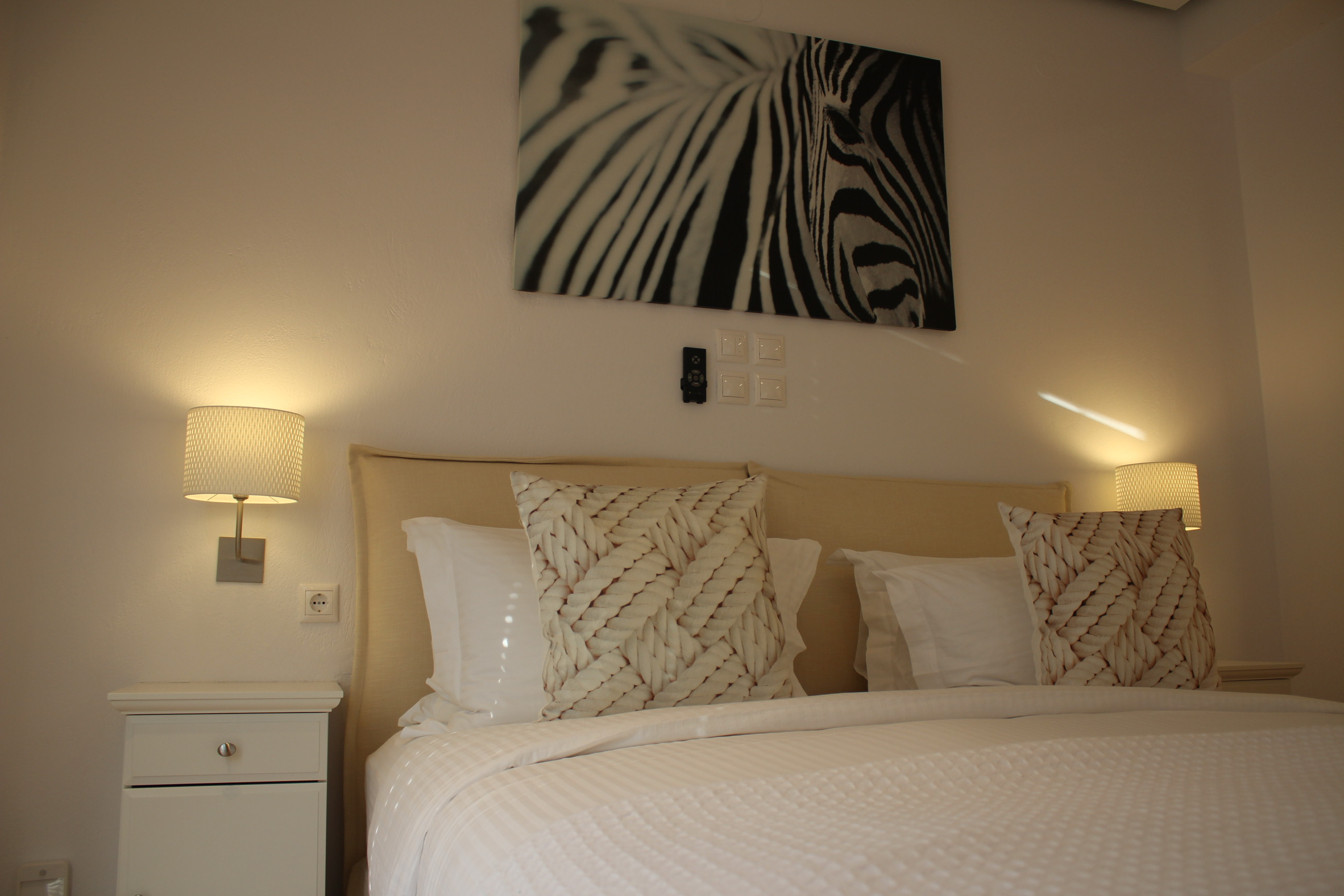 Zebra picture above the bed