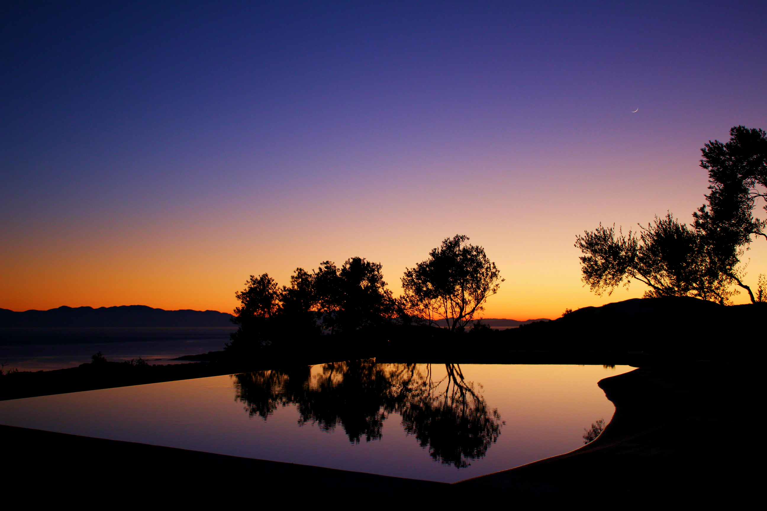 Silhouette Over The Infinity Pool