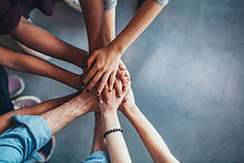 Stack Of Hands Showing Unity And Teamwork.jpg