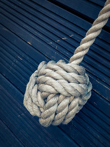 Nautical knot on a blue wooden background.jpg