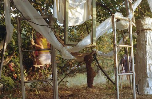 lora performing in her installation.jpg