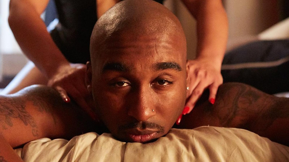 Tupac, played by Demetrius Shipp Jr., gets a massage. Still via Facebook