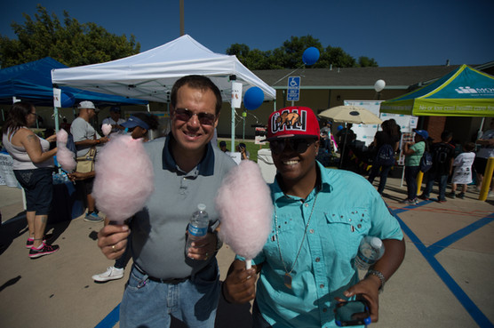 prade attendees posing for a photo while holding candy floss