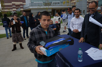 picture of s.t.e.m student holding laptop