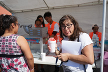 event attendee holding a snow cone