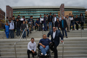 image of s.t.e.m participants standing outside on the steps of the collage campus