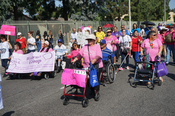 attendees from the SCRS womens group walking along the parade route
