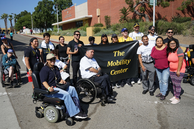event attendees holding a sign representing the CAL State LA Mobility Center