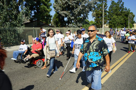 image of parade atendees walking along the parade route