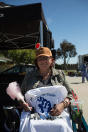 prade attendee holding comemorativ event t-shirt