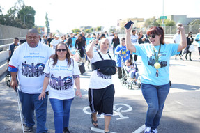 Event attendees walking along the parade route