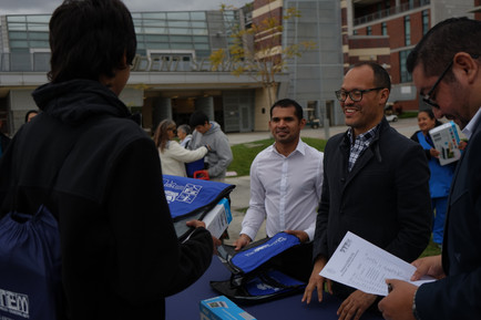 picture of scrs staff with students holding a boxed laptop