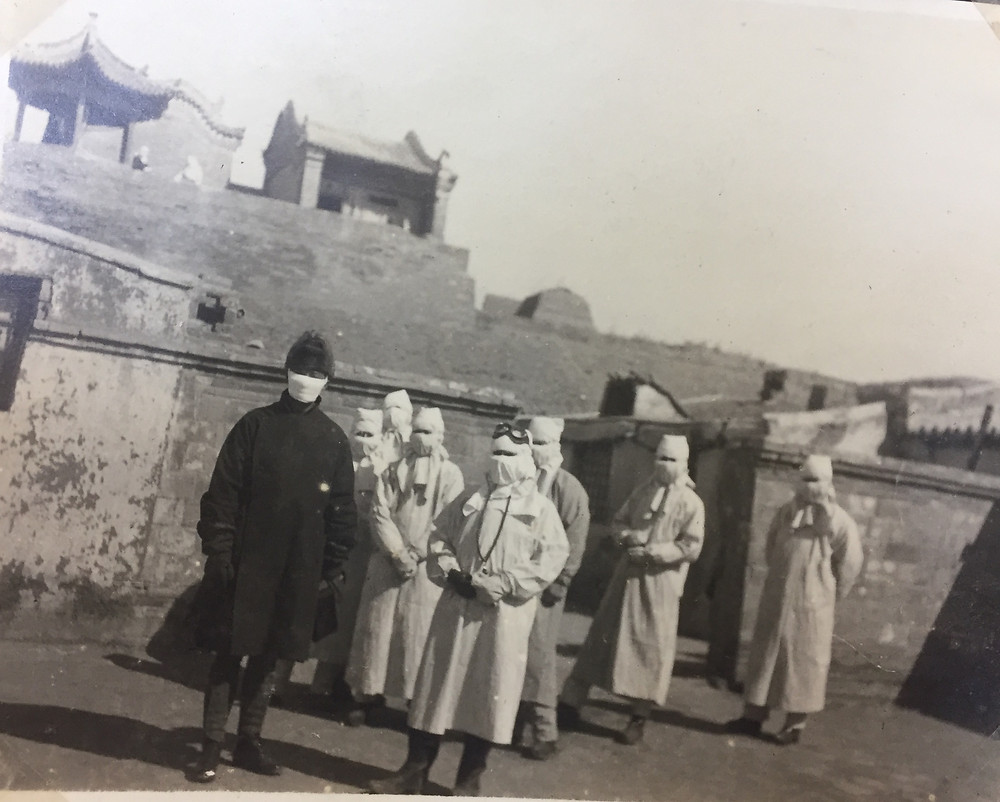 Datong, Shanxi, 1918. A team of medical professionals inspect the walled city.