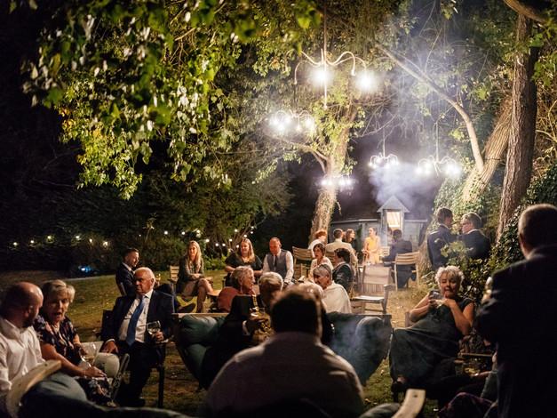 night garden lit by chandeliers