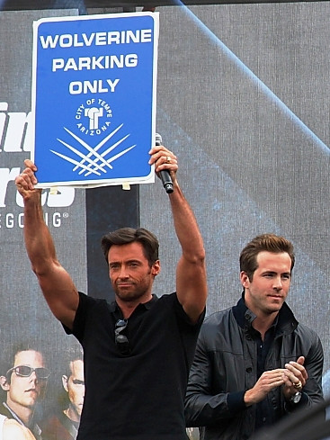 From left to right on stage: Hugh Jackman and ...