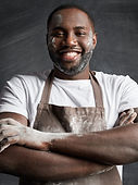 cheerful-plump-black-man-wears-apron-has