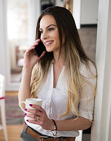 beautiful-woman-using-cell-phone-and-dri