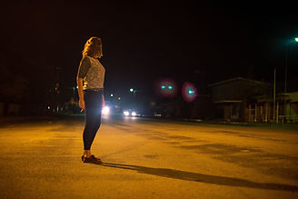young-woman-working-the-street-waiting-for-a-clien-V39743R.jpg