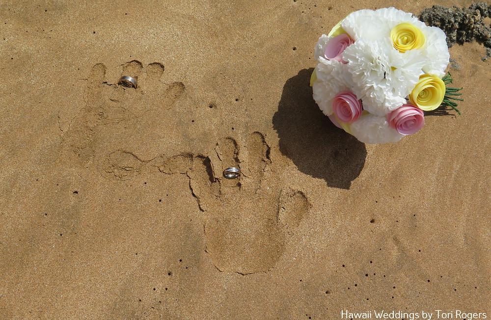 handprints on the sand