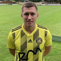 Midfielder signs from Salisbury.