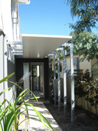 Insulated covered walkway