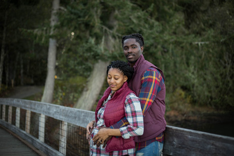 fall couples maternity pictures on bridge