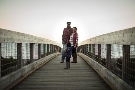 family maternity pictures on bridge