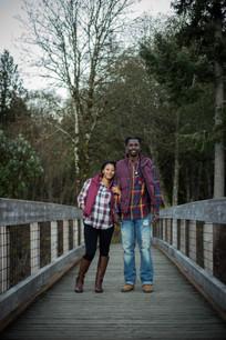 couples maternity pictures on bridge