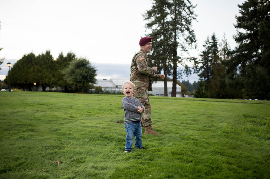 candid childhhood photography of boy and his military father in Olympia, WA. Photography by A Bit O' Whimsy