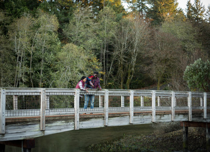 family pictures on a bridge
