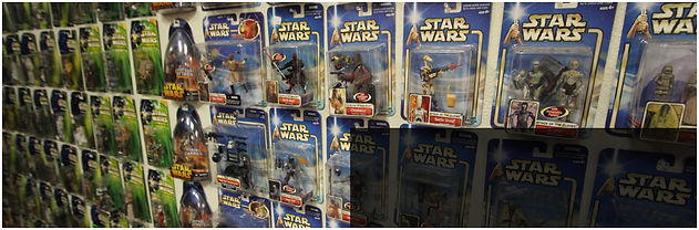 Star Wars and Superhero action figures inside toystore