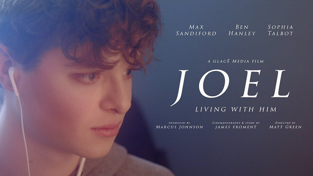 The face of a teenage boy stares vacantly to the side where the film's title and cast are listed.