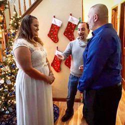 Minister Lipari exchanging Christmas vows.