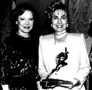 Hillary Clinton presents to Rosalyn Carter