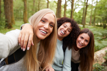 three-young-adult-women-taking-a-selfie-
