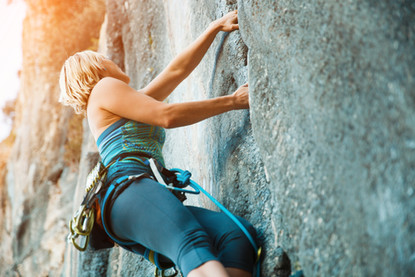 rock-climbing-on-vertical-flat-wall-stoc